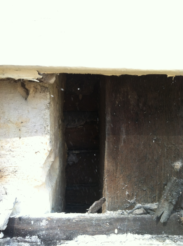 Closeup of large skrinkage gap where tripolymer or polyurea type foam was used in an existing wall