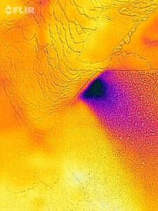 Infrared view of a small leak in a spray foam job