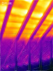 Infrared view of partially foamed attic. Note how the foam reduces the summer heat from coming in.