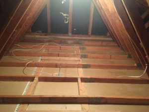 Attic cleaned out and ready for air sealing. No more critter pee and poo.