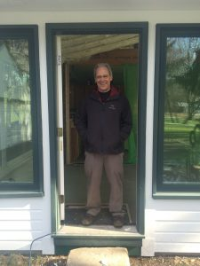 Kevan standing in the doorway of his newly upgraded home.
