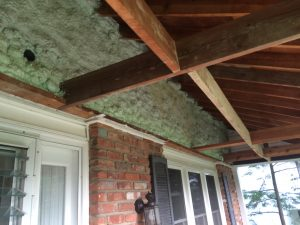 Closer shot of spray foam on knee wall over front porch
