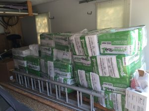 Cellulose insulation ready to be installed DIY by Energy Smart Home Performance clients.