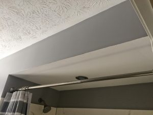 Typical dropped soffit in a bathroom, these things leak badly 90% of the time.