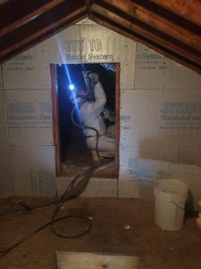 Spray foam being applied to a knee wall attic roof in a 1970s Cape Cod home by Affordable Foam of Medina Ohio