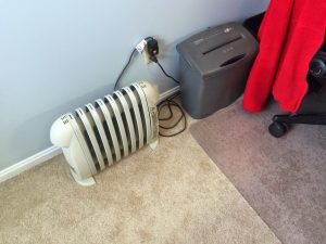 Space heaters and sweatshirts are classic indicators of discomfort