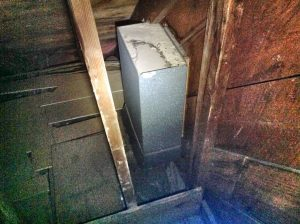 This laundry chute was outdoors. It let a lot of cold air into the hallway upstairs and the laundry room below.