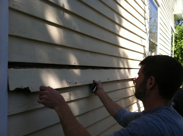 Taking A Piece Of Wood Siding Off My 1835 Home To Expose The Foam Insulation In